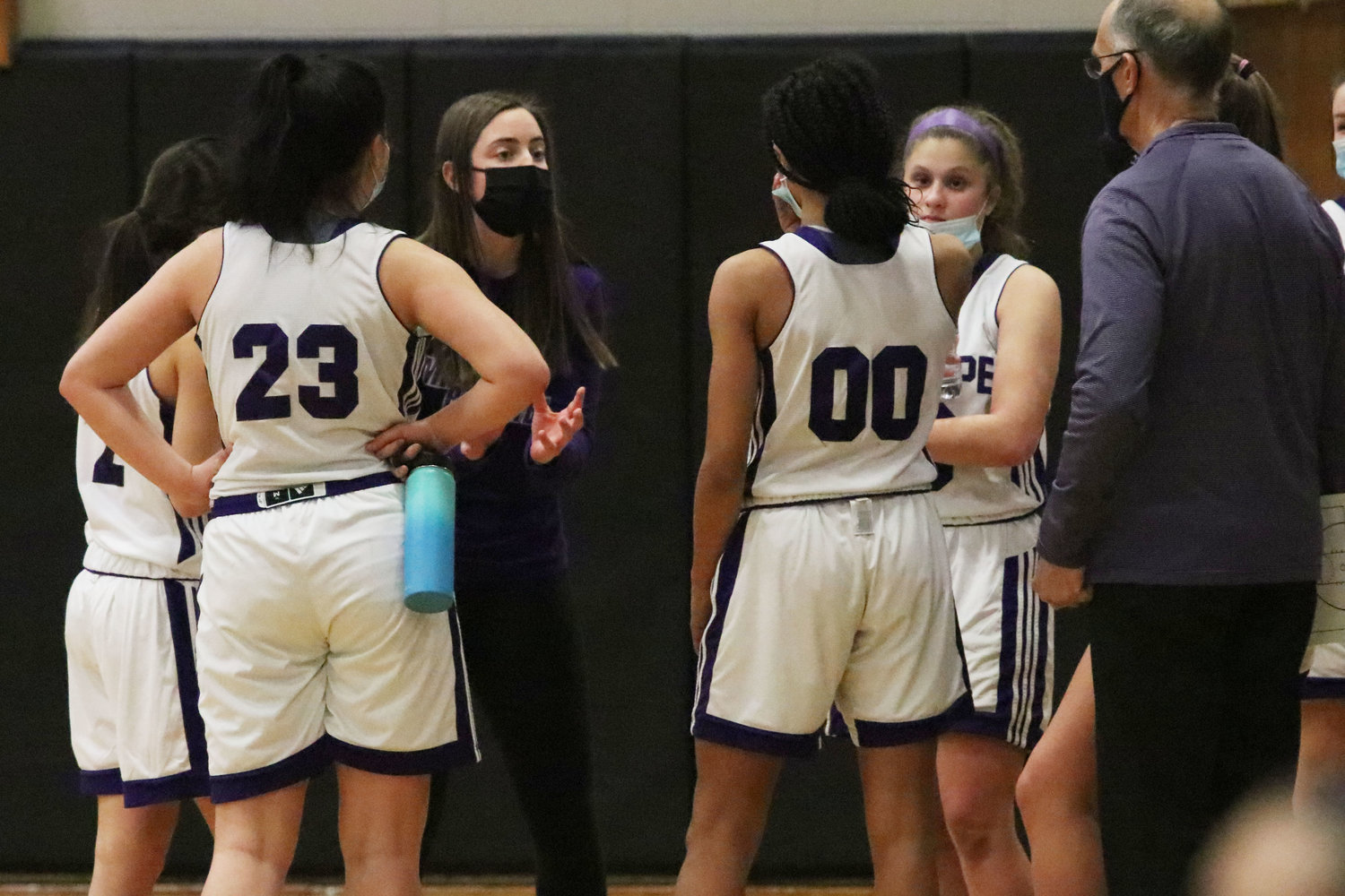Coach Katie Kline speaks to the team during a time out in the first half.