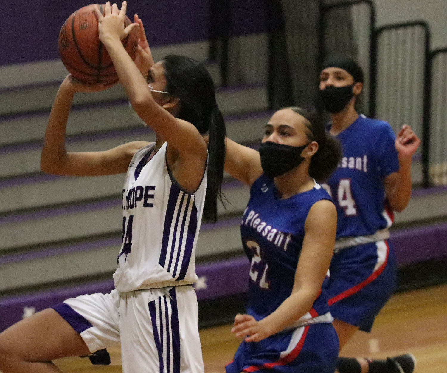 Point guard Junior Aditi Mehta drives in for a layup in the first half.