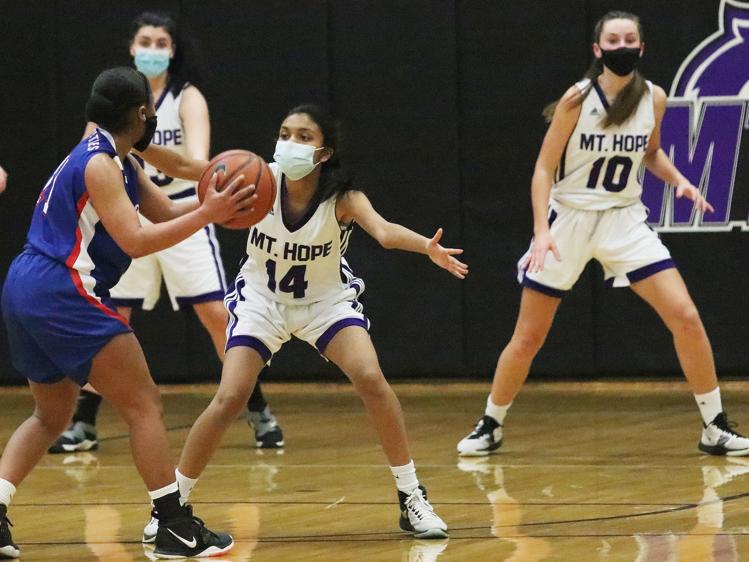 Point guard Junior Aditi Mehta (middle) and teammates Isabel Savinon (left) and Reyn Ferris set up on defense.