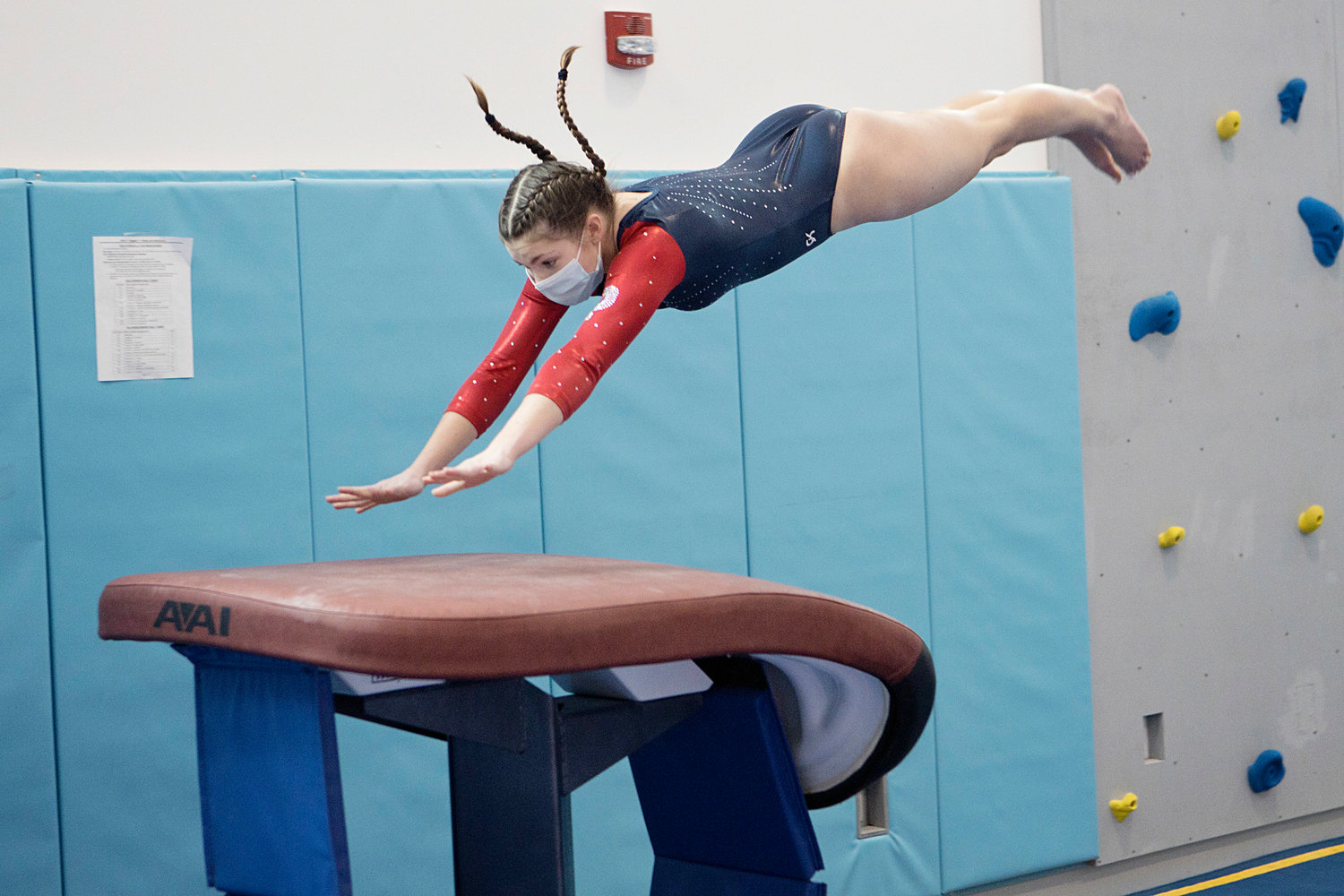 Portsmouth High's Jordan Burnley dives onto the vault while competing in the Region 1 State Gymnastics Championships on Saturday. Burnley earned an 8.85 on the event and led the Patriots with an all-around score of 33.25.
