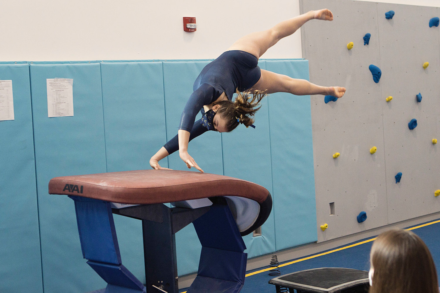 Lily Da Ponte executes a stunt on vault during the Region 1 State Championships, Saturday, at the Newport YMCA. Da Ponte earned an 8.30 on the event.