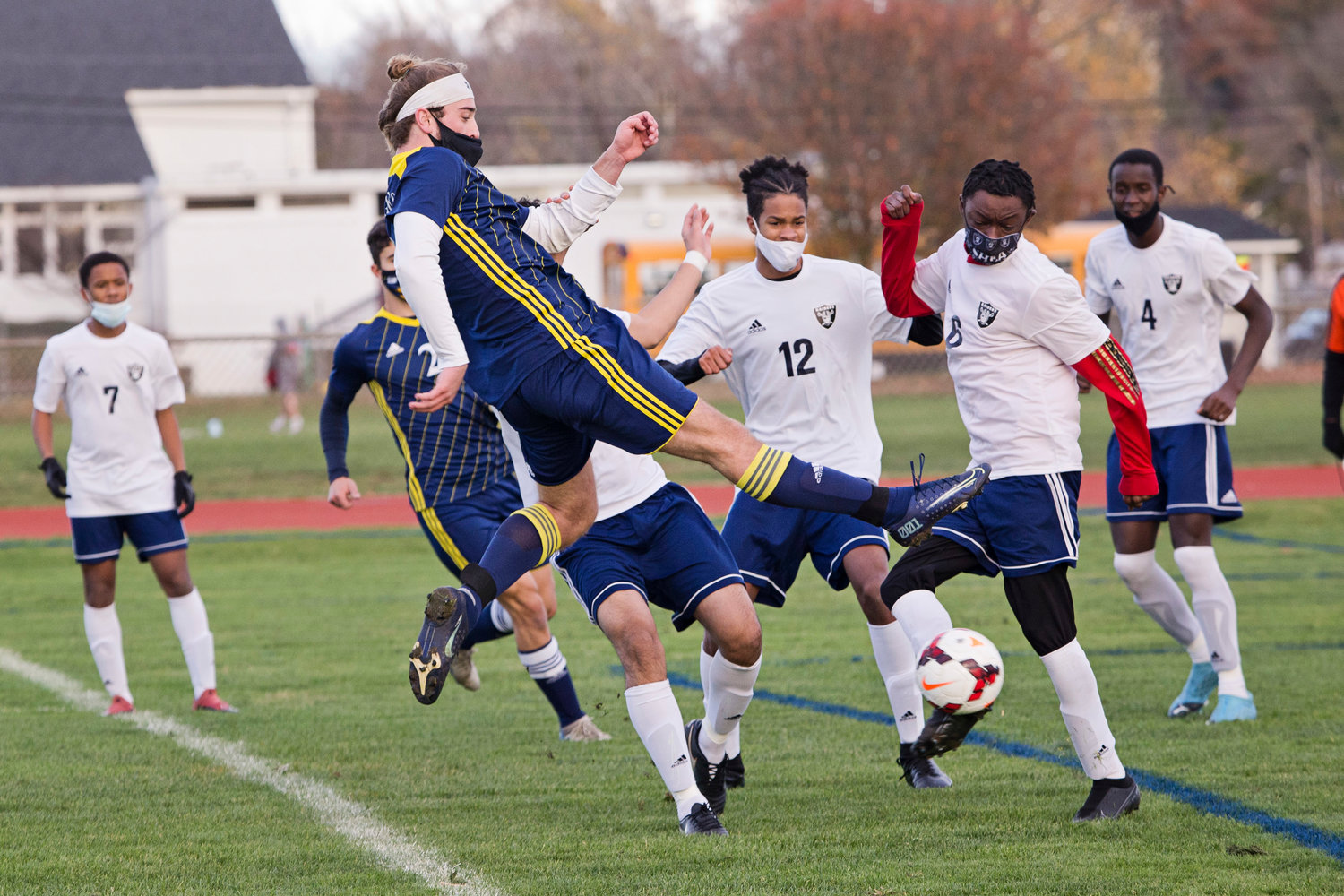 Barrington High School's Jackson Bennett flies through the air to connect with a shot on goal during a game this fall. Jackson was recently selected to the United Soccer Coaches Association's All American team.