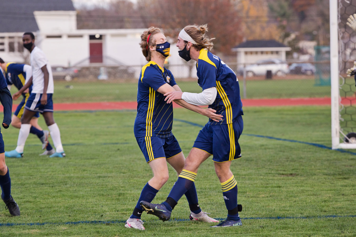 Barrington's Jackson Bennett (right), shown celebrating a goal with a teammate this season, was one of the few defenders to be selected to the United Soccer Coaches Association's All American team.