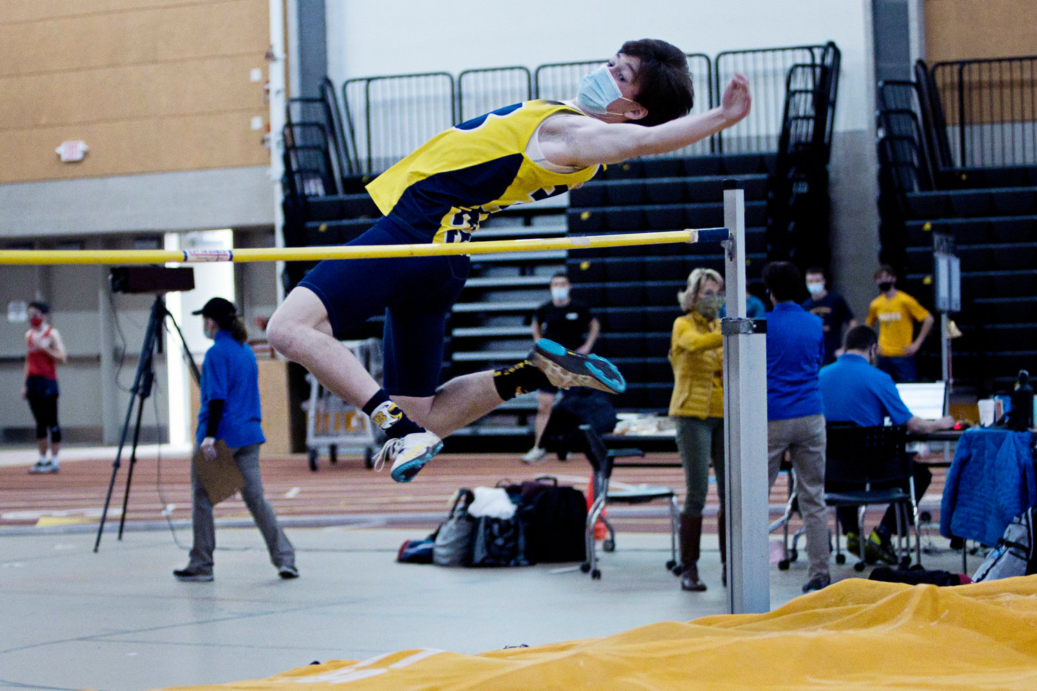 Barrington's Thomas McAdams clears the bar while competing in the boys high jump event at the Indoor Track State Championships, Saturday.