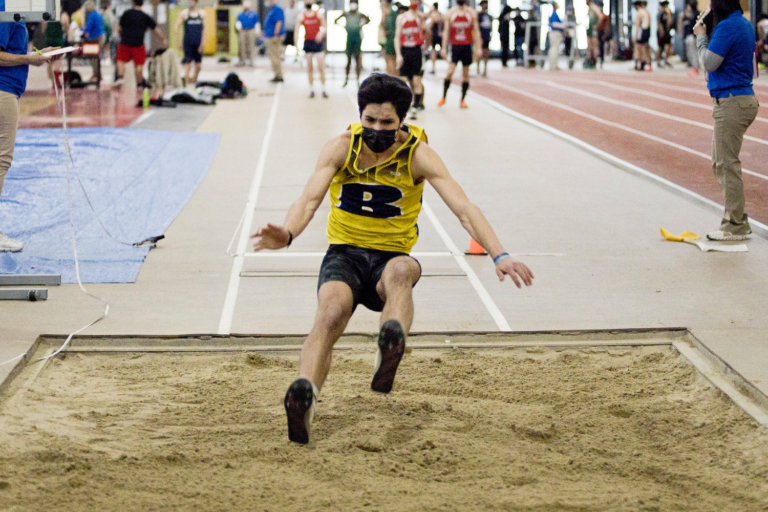 Barrington's Will Sanchez competes in the boys long jump event at the Indoor Track State Championships, Saturday.