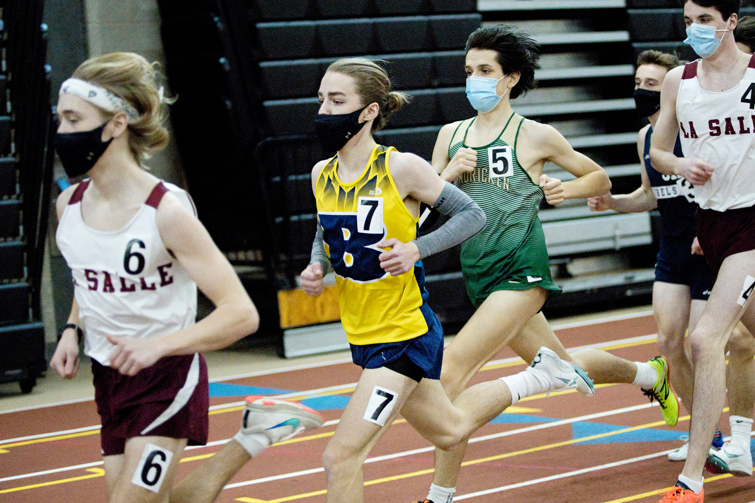 Barrington's Holden Vaughn keeps his pace while competing in the boys 1500 meter run at the Indoor State Championships, Saturday.