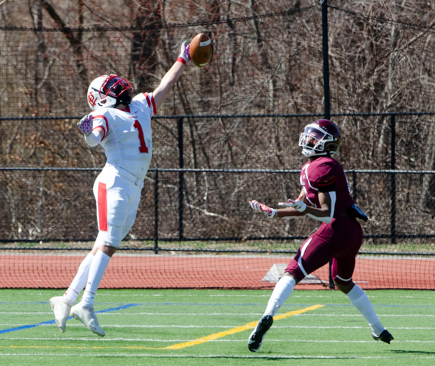 EPHS safety Ilyas Torres breaks up a LaSalle pass attempt during the Townies' 2021 season opening game against the Rams Saturday, March 27.