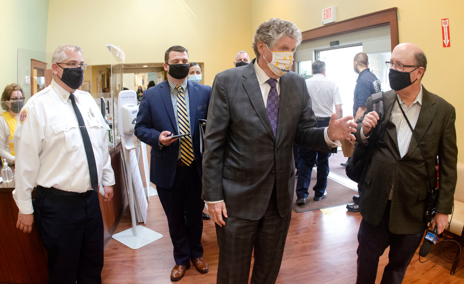 Governor Daniel McKee tour the East Providence vaccination site.