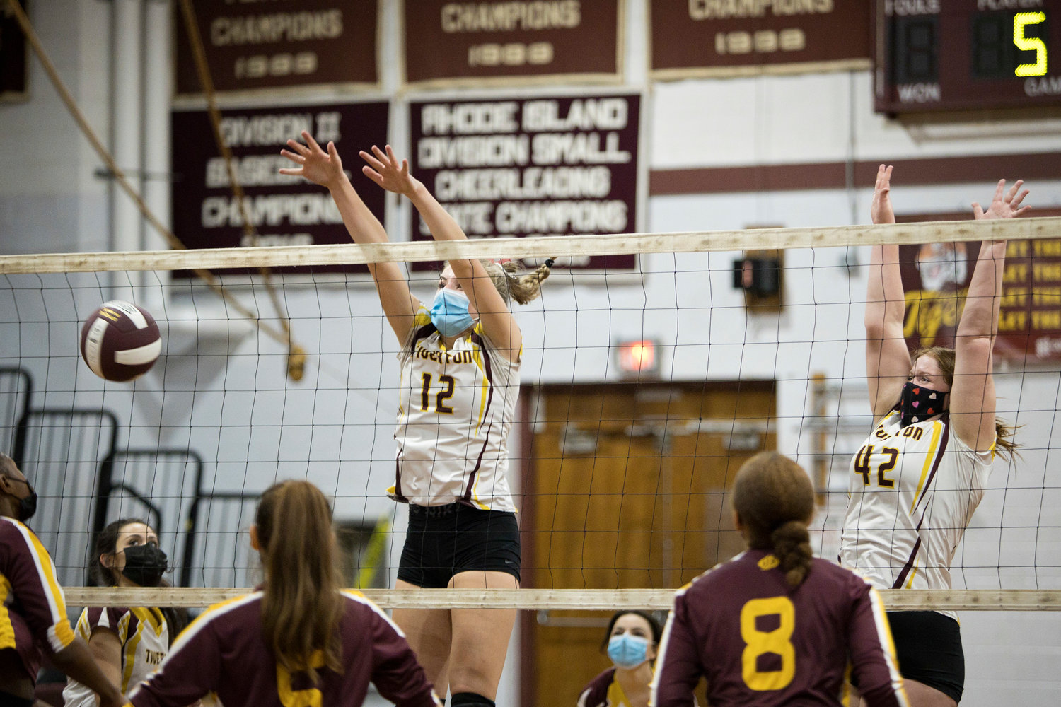 Molly Richardson and Madison Pelletier (right) block at the net during Friday night's game against Times Two Academy.