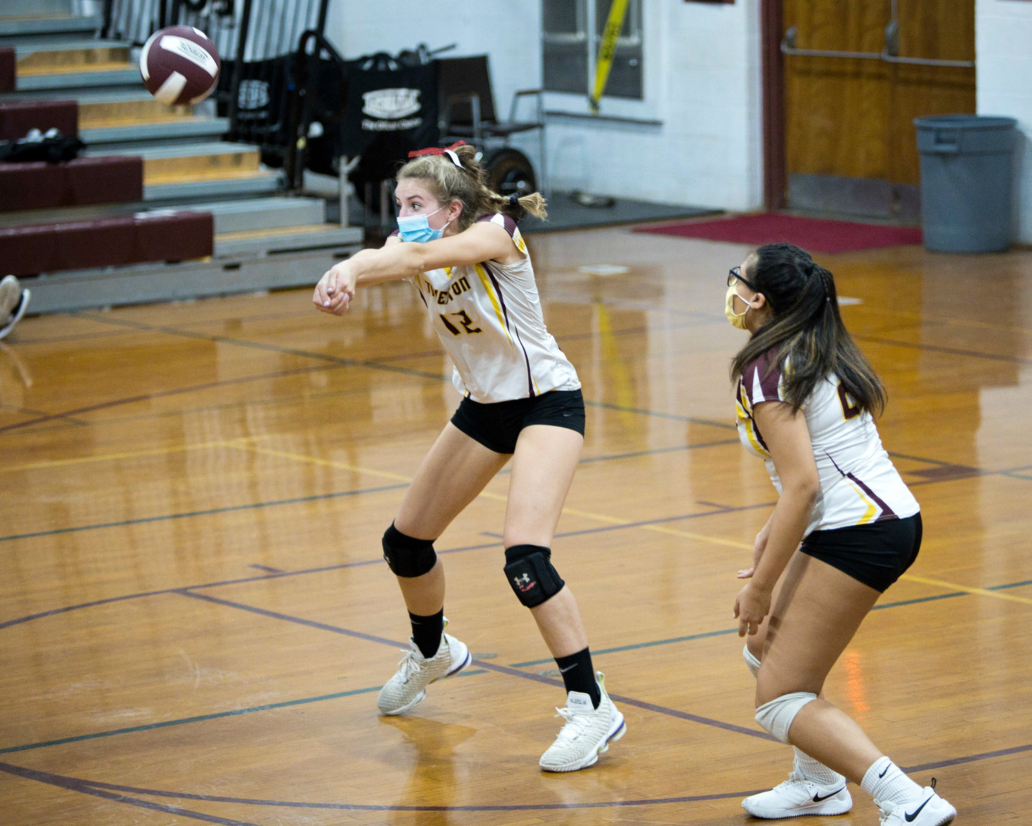 Molly Richardson receives a serve from Times Two Academy, Friday night.