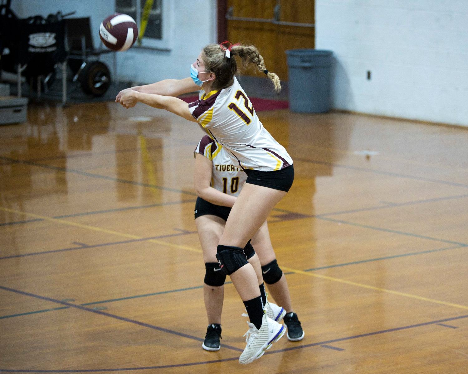 Molly Richardson sends the ball back over the net during Friday night's game against Times Two Academy.