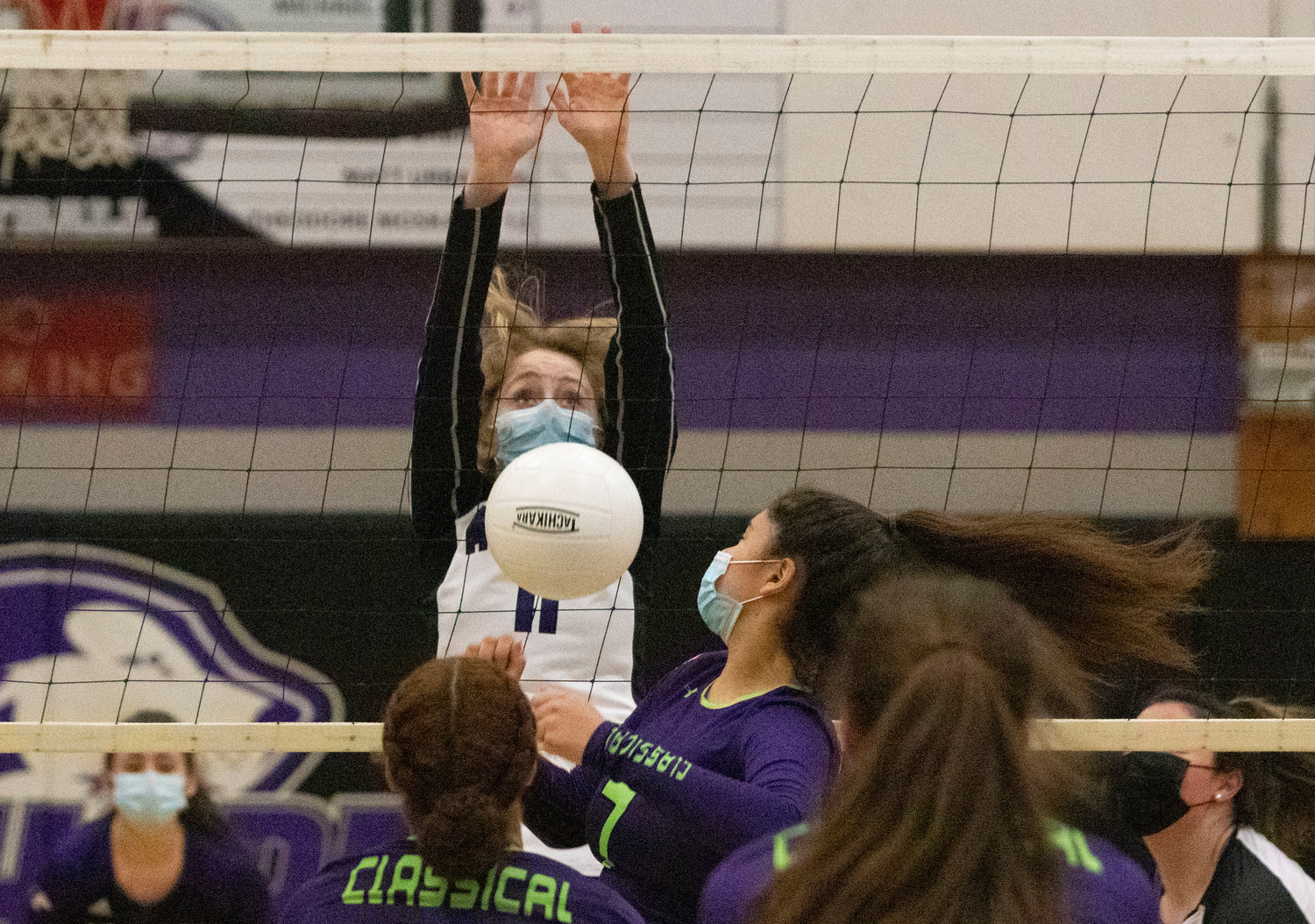 Sophomore Jillian Brown watches her block fall for a Huskies point.