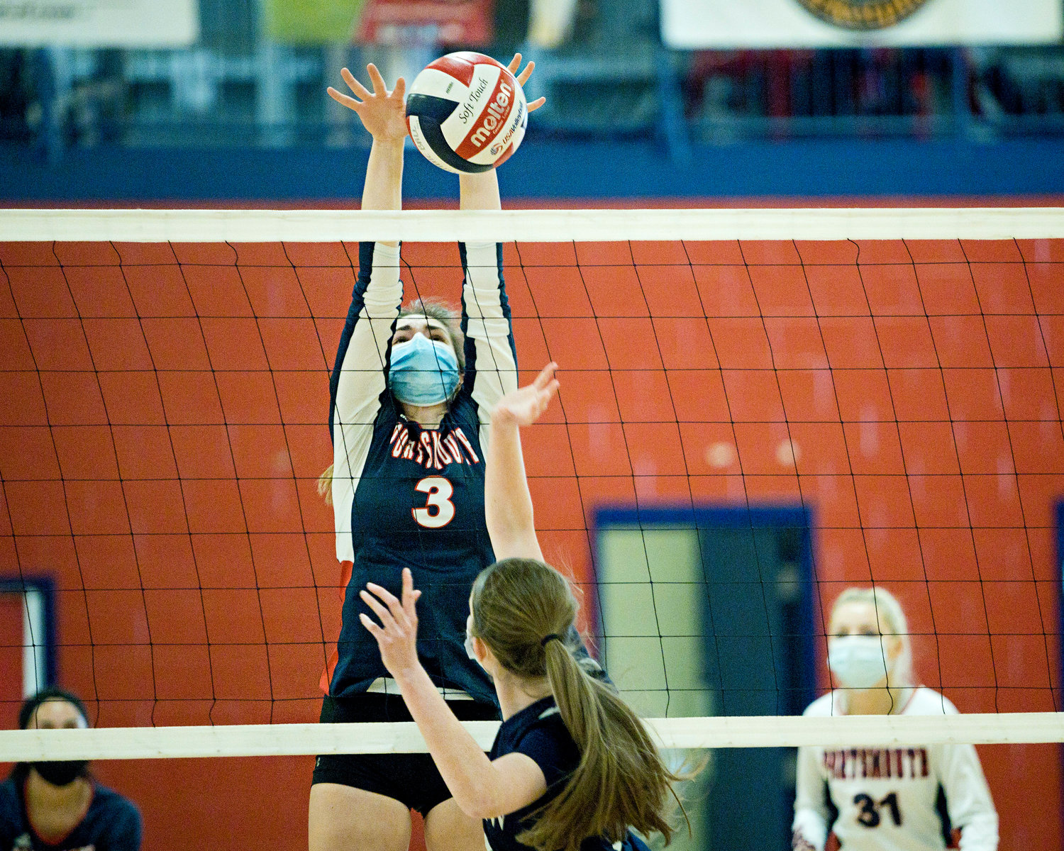 Erin Anderson stops the ball from coming back over the net against Bay View.