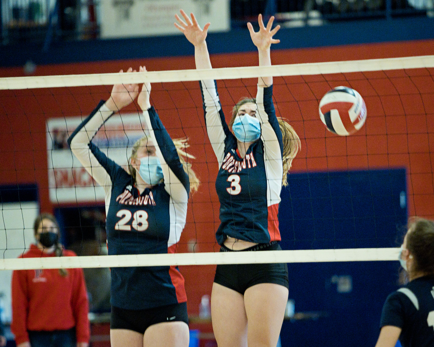 Tatum Horley (left) and Erin Anderson block the net as Bay View attempts a shot.