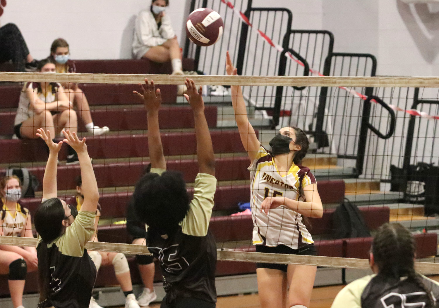 Kaylie Cabral hits the ball over the hands of the Davies blockers for a winner.