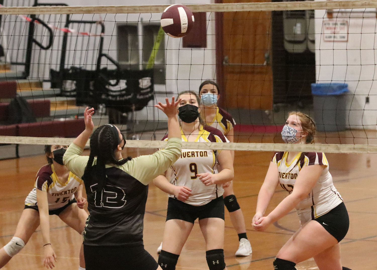 Kaylie Cabral (left), Abbie Monkevicz, Savannah Goss and Abby Arruda ready as a Davies hitter hits the ball.