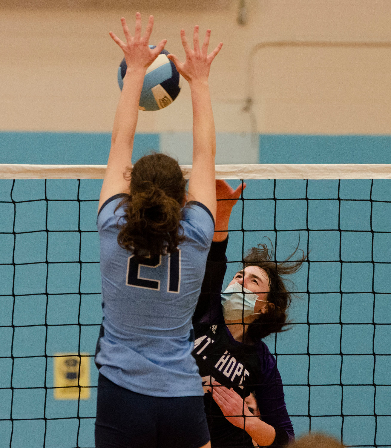 Hannah Rodriques slams the ball over the net for a kill during the Huskies quarterfinals match against Johnston on Tuesday night.
