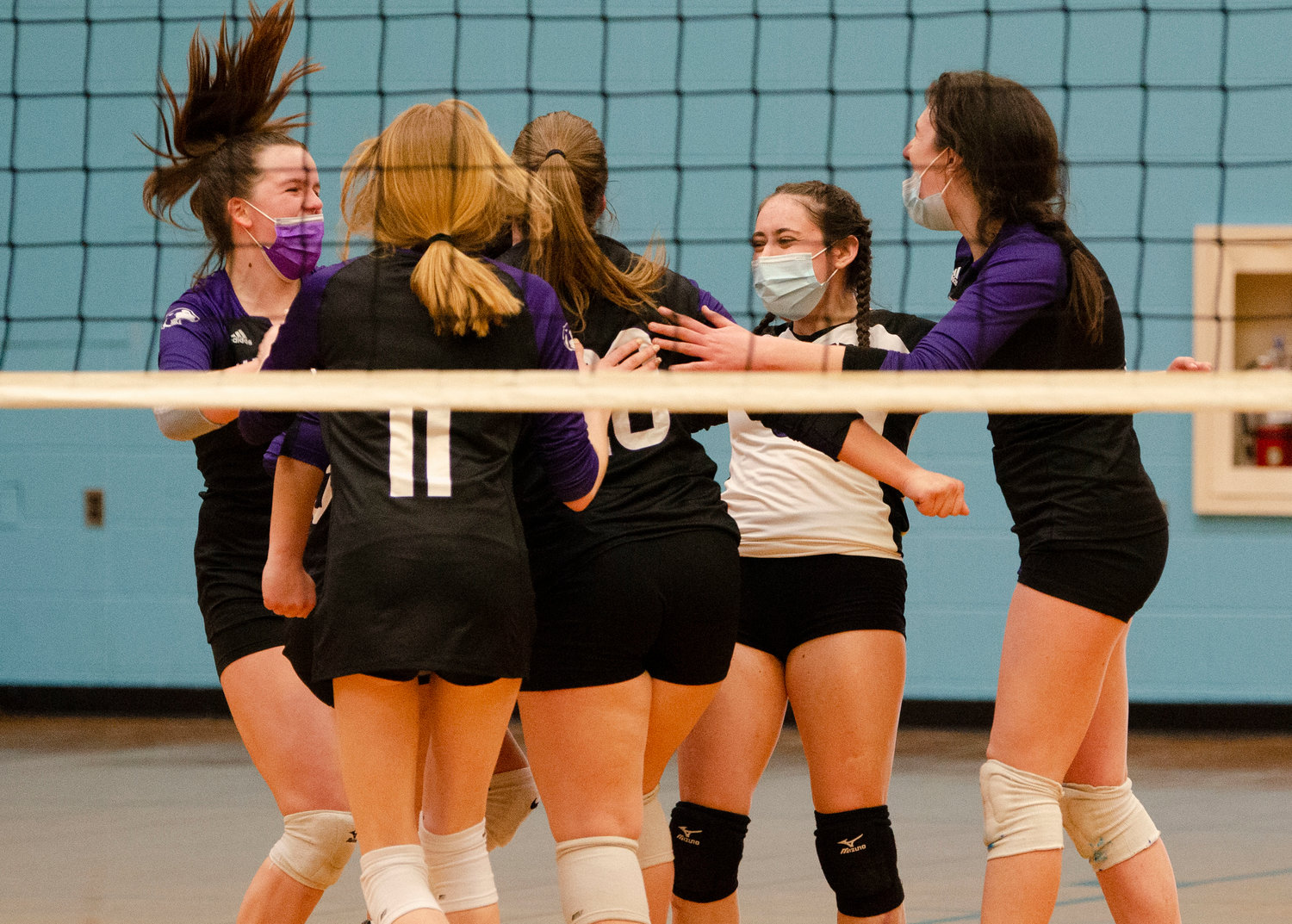 Mia Shaw, Jillian Brown, Christina Frenette, Abby Ferreira, and Hannah Rodriques celebrate after a Huskies point.