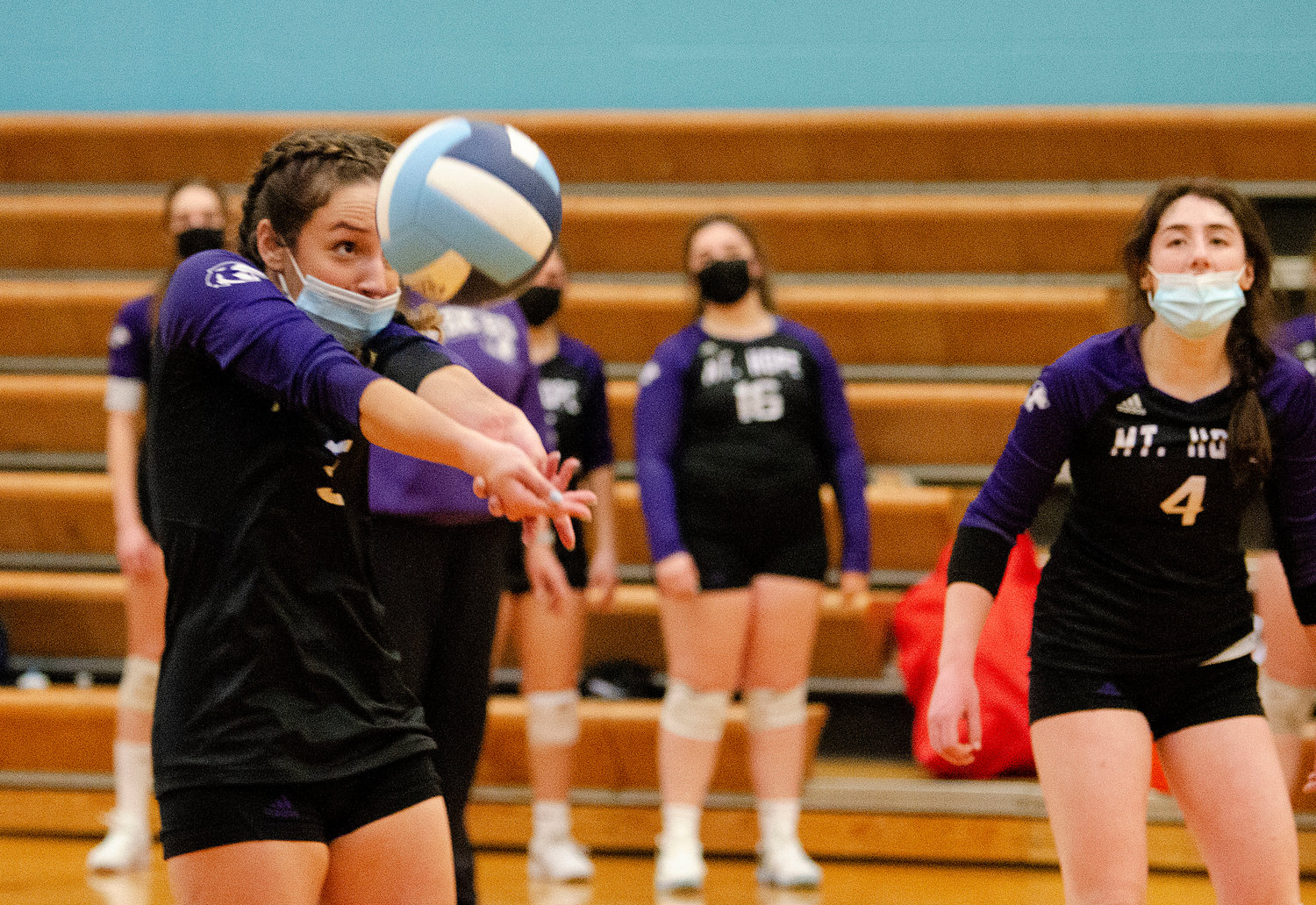 Isabel Savinon volleys the ball (left) with Hannah Rodriques looking on during Mt. Hope's quarterfinals match against Johnston on Tuesday night.