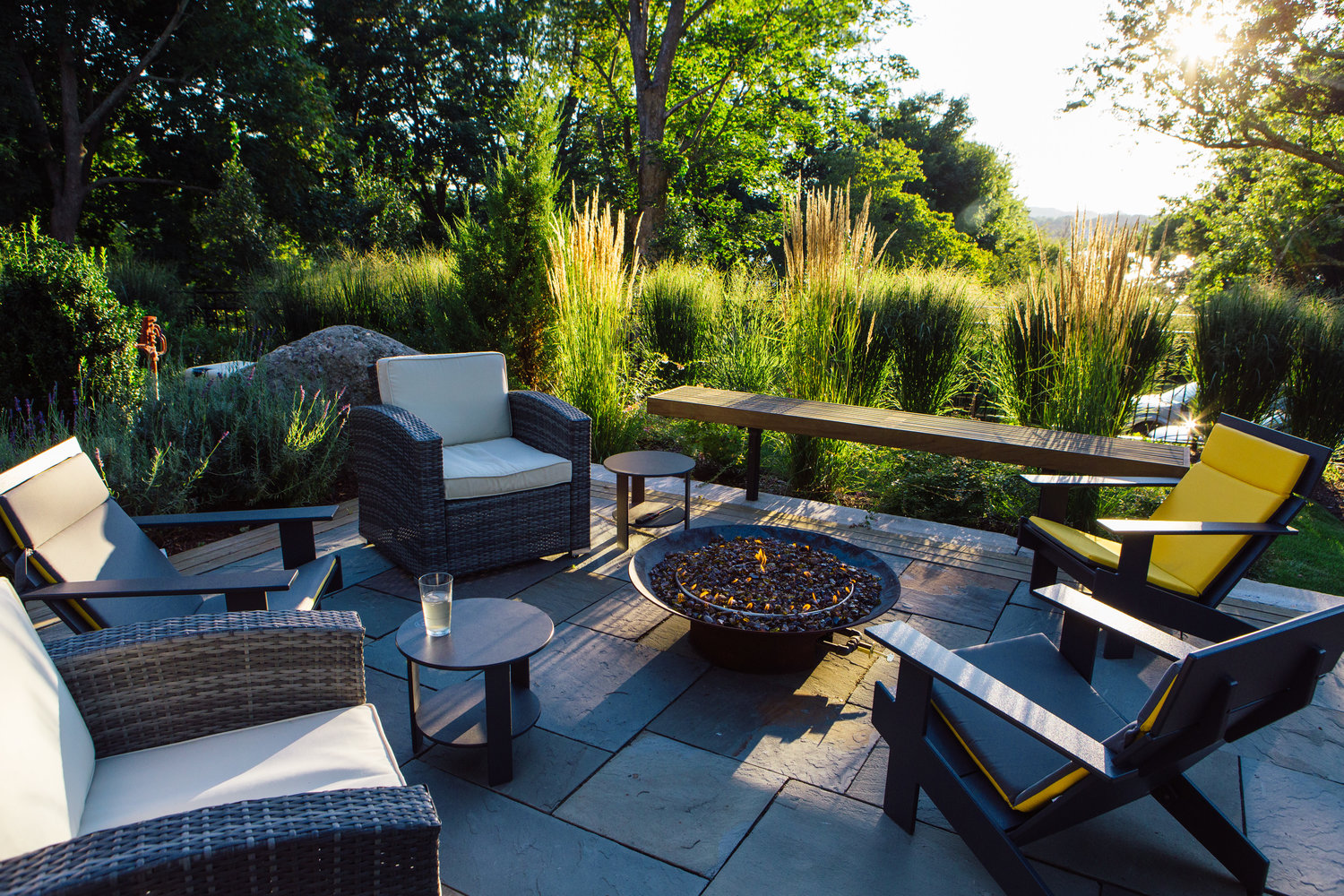 The fire pit area adjoining the pool enjoys its own private space, with natural grasses providing the relaxing atmosphere one would expect in this setting.