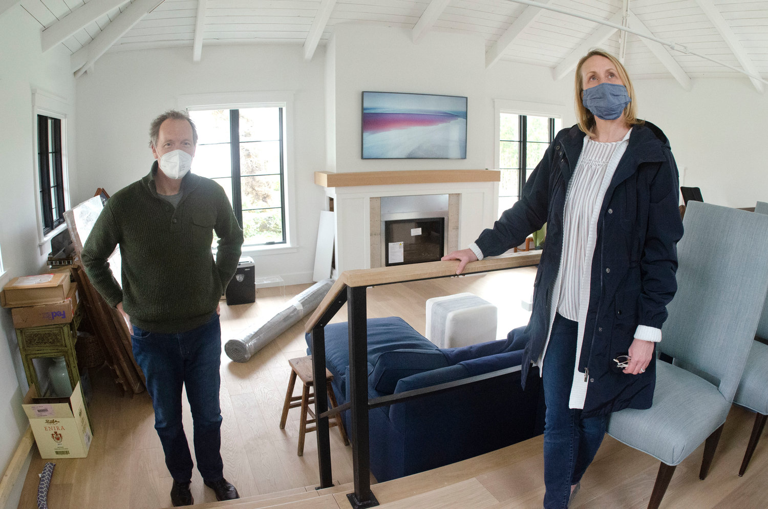 The Iseleibs are doing a major renovation of their new home, with the help of architect Cory Kallfelz (right).