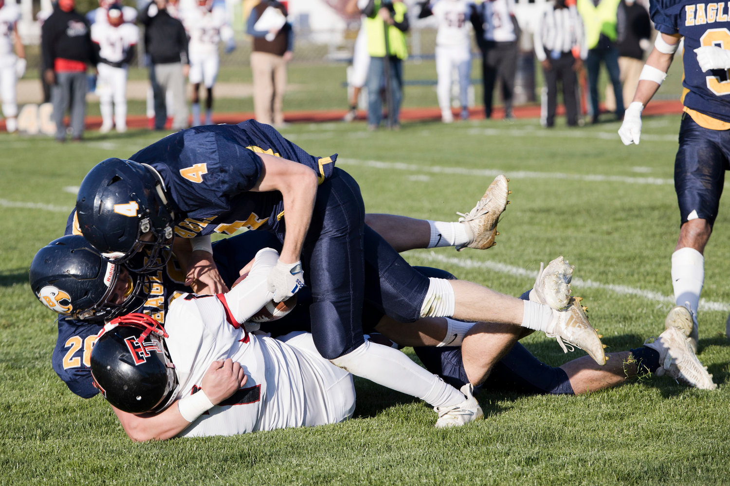 Barrington's Luke Gorham (left) and Brigham Dunphy tackle a Tolman opponent during the Division II semifinals, Friday.