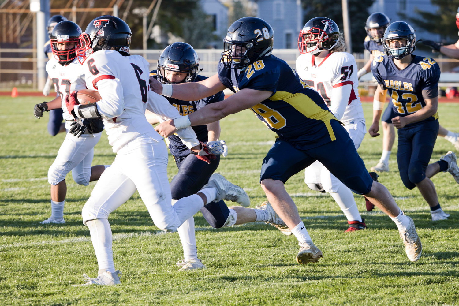 Barrington's Luke Gorham slows down a Tolman opponent during the Division II semifinals, Friday.