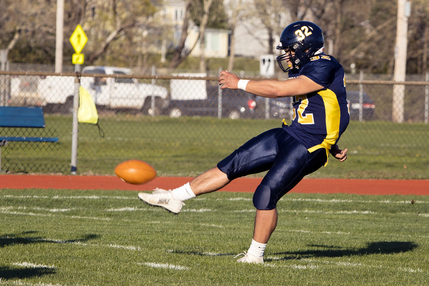 Tom Rocha unloads a kick for the Eagles on Friday.