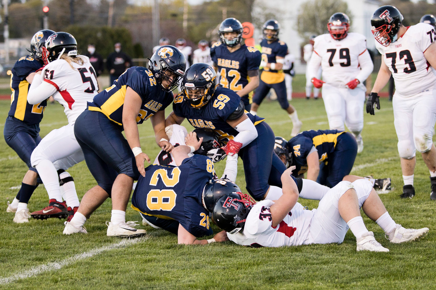 Tom Rocha (32), Luke Gorham (28), and Sergia Da Silva (59) tackle a Tolman opponent during the Division II semifinals, Friday.