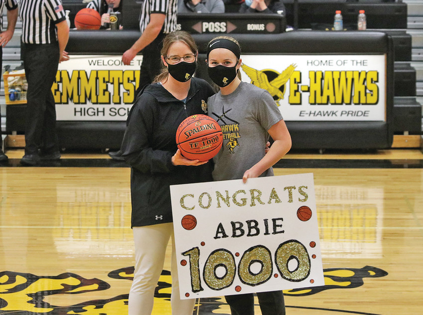 1,000 POINTS -- Abbie Schany, pictured with Lady E-Hawk Head Coach Anny Fiene, earned her 1,000th career point Friday night during Emmetsburg's 49-24 win over the West Bend-Mallard Wolverines. Schany, a senior at Emmetsburg High School, put 18 points on the scoreboard during Friday's home contest amidst cheers from family and friends.