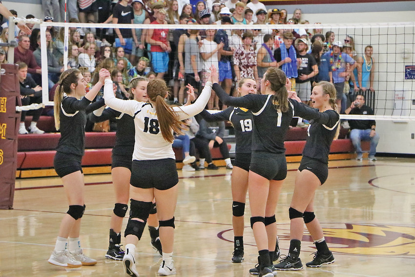 TEAM SPIRIT -- The Lady E-Hawks would fall 0-3 against Western Christian in the Class 2A Regional Championship last Wednesday, finishing the 2020 season at 18-7 overall. Pictured, though the girls would struggle against a tough Wolfpack team, they kept their spirits high throughout the contest. -- Joseph Schany photo