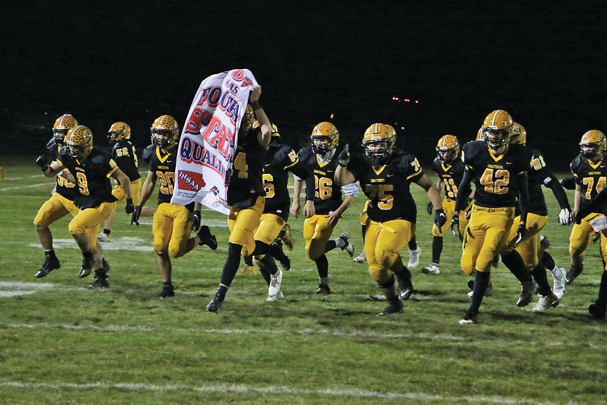IHSAA CLASS 1A STATE QUALIFIERS -- The E-Hawks celebrate their 42-14 victory over Carroll Kuemper Friday night. Following the contest, Emmetsburg was awarded IHSAA Class 1A State Qualifiers. -- Joseph Schany photo