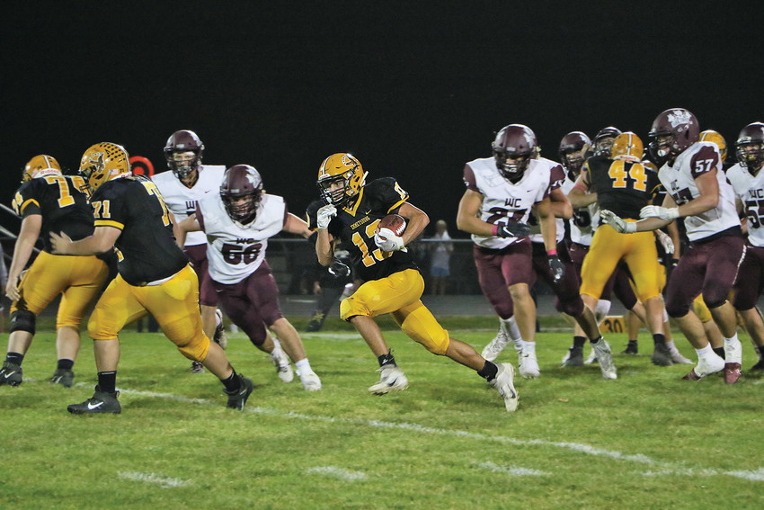 CADE SHIRK picked up 28 yards on the ground and 48 through the air Friday night. The E-Hawks totaled 211 yards of offense against the Wolfpack.      -- Joseph Schany photo