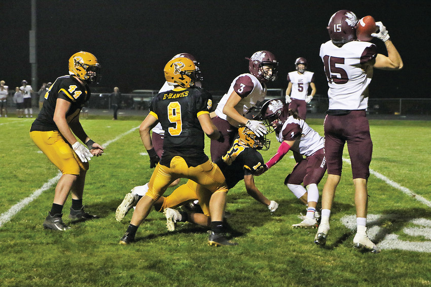 OH SO CLOSE -- With seconds left on the clock and behind by three points, Emmetsburg's Ben Dunlap would find Cade Shirk at the 5-yard line for a 26-yard pass on 4th & 20. Unfortunately, Western Christian would force the ball loose to take possession and the 10-7 win. Pictured (from left) Matt Wirtz, Lex Kassel, and Shirk helplessly watch as the ball comes to rest in Wolfpack arms. The loss is Emmetsburg's first this season.       -- Joseph Schany photo