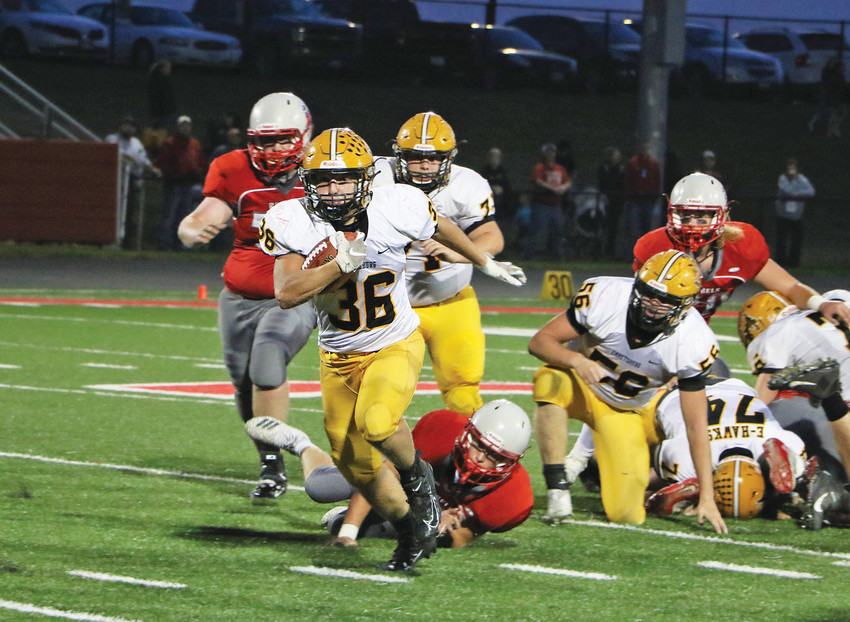 EXTRA EFFORT -- Colby Weir drags a Rebel defender along for the ride during a first down pick up last Friday night. Weir would score two touchdowns on the night and rush for 106 yards against Sioux Central. -- Joseph Schany photo