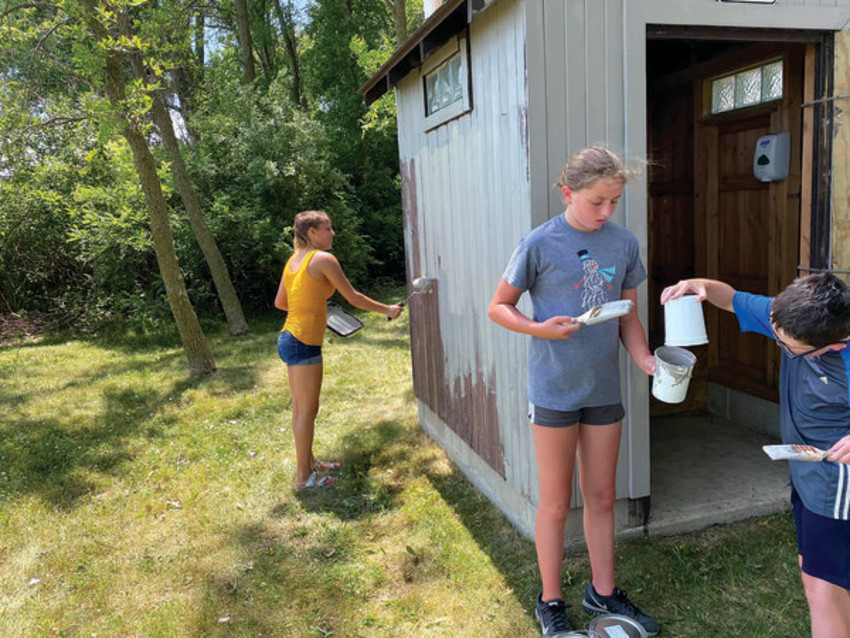 PAINTING THE OUTHOUSE (pictured, from the left) Hannah Sanders, Sloan Rodemeyer and Cael Rodemeyer at Duhigg Park.