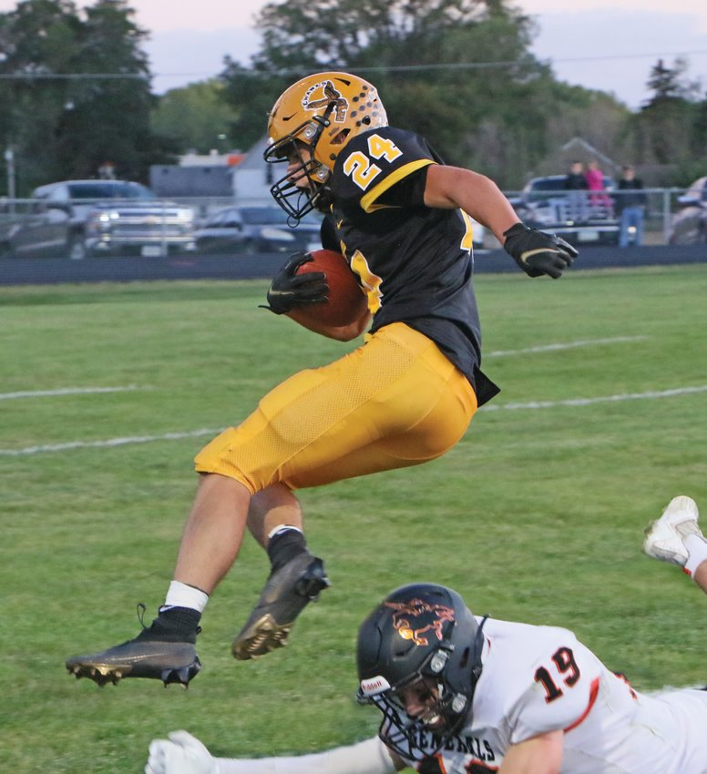 Seth Freeman leaps into the end zone during Emmetsburg's 63-21 Homecoming win over Sibley-Ocheyedan.