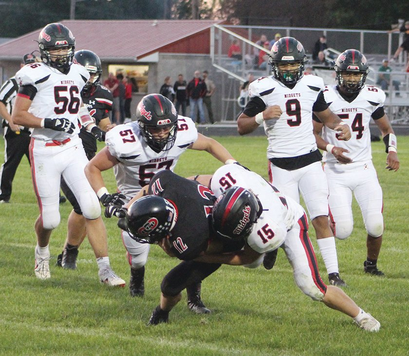 Although he had plenty of backup, ELC senior Seth Busch (15) makes the stop by himself on this play against Clarion-Goldfield-Dows on Friday. Other ELC defenders ready to assist are Jack Jensen (56), Zander Snyder, (57), Zavion McMurran (9), and Alex Pena (54).