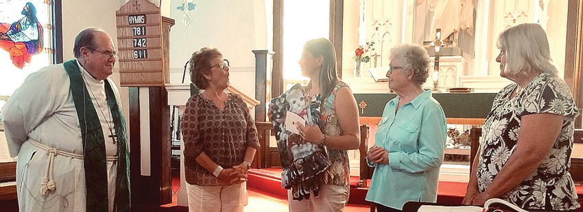 From left: the Rev. Bruce Burbank, chair Minnie Lieb, Kaydra Heller and grandmothers Shirley Heller and Rhonda McPeek. St. John's Lutheran Church recently donated $8,152.23 to the Heller family.
