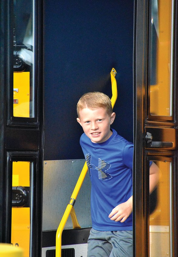 Third grader Eli Schumacher arrives at Galena Primary School to begin his first day on Friday, Aug. 16.