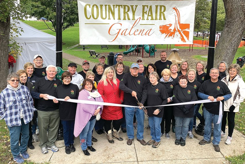 The ribbon was cut Friday morning, Oct. 11, for the 40th annual Galena Country Fair. Back row, from left: Mike Virtue, Jay Dickerson, Paul Jackson, Andy Miller; middle row: Michelle Townsend, Drew Townsend, Jerry Howard, James Lyne, Linda Virtue, Nancy Brashaw, Frances Beadle, Teresa Rowe, Kimberly Miller, Joellen Holland, Michelle Murdock, Wendy Gilpin; front row: Carol Gebelt, Denise Spielman, John Cox, Bonnie Cox, Cindy Foley, Kathie Farlow, Kerry Shelke, Ron Smith, Pat Smith, Joan Ricketts, Mary Ellen Lyne, Tracy Furlong, Ed Bochniak and Kimberly Howard.