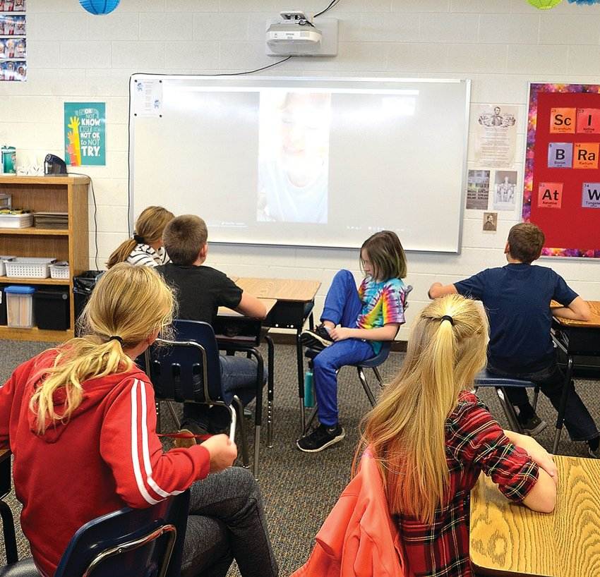Students in one of Amy Haase's fifth-grade science classes at Galena Middle School were glued to the screen as they listened to a microbiologist from the New York State Department of Public Health answer questions and explain her job.