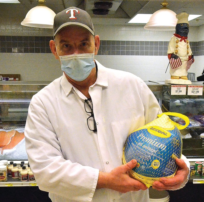 Mark Lawrence, meat manager at Tammy's Piggly Wiggly with one of the turkeys available for this Thanksgiving season. While some are buying smaller birds due to the pandemic, others are purchasing the usual size with plans for leftovers.