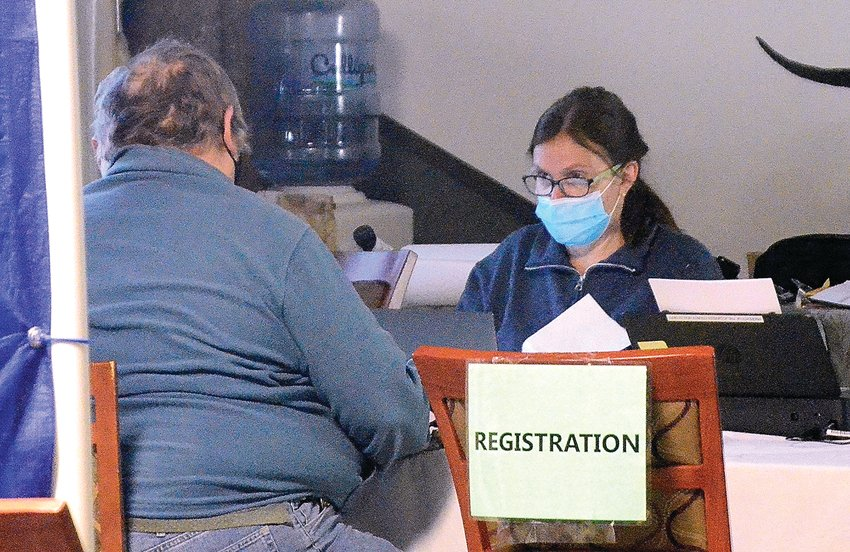 Lori Stangl, director of clinical services at the Jo Daviess County Health Department, registers an individual at a vaccination clinic held on Thursday, March 25. As the county continues to vaccinate residents, there has been a rise in cases of COVID.