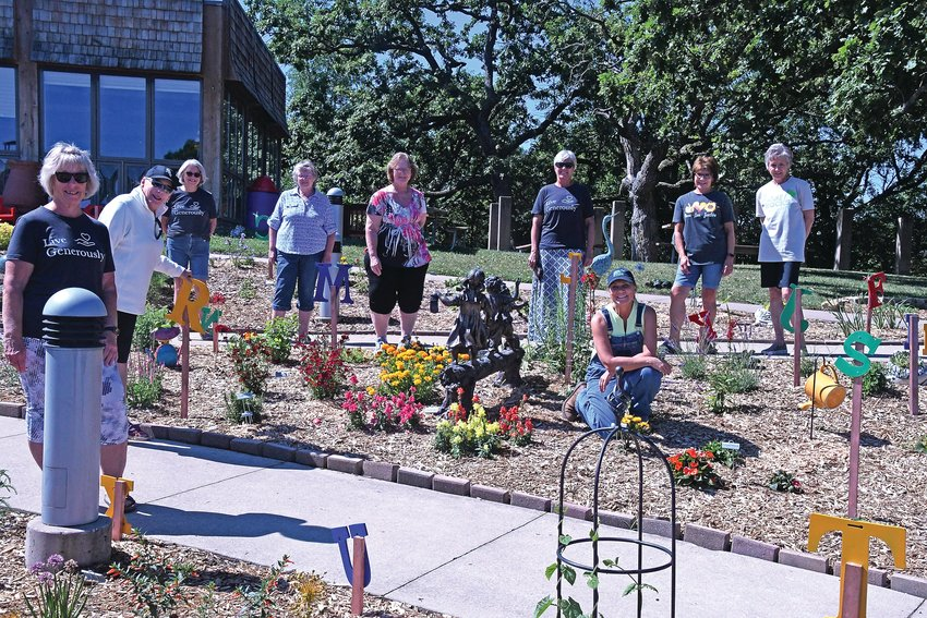 Members of the Apple Canyon Lake Children's Garden committee stand in the children's garden that is set to open on Saturday, June 26 at 10 a.m. Members pictured are, from left, Deb VanDerLeest, Cindy Finley, Kathy Woznicki, Carolyn Beckel, Charmaine Magee, Ann Yorke, Therese Nelson (kneeling), Kathy Rogers and Dianne Carr.