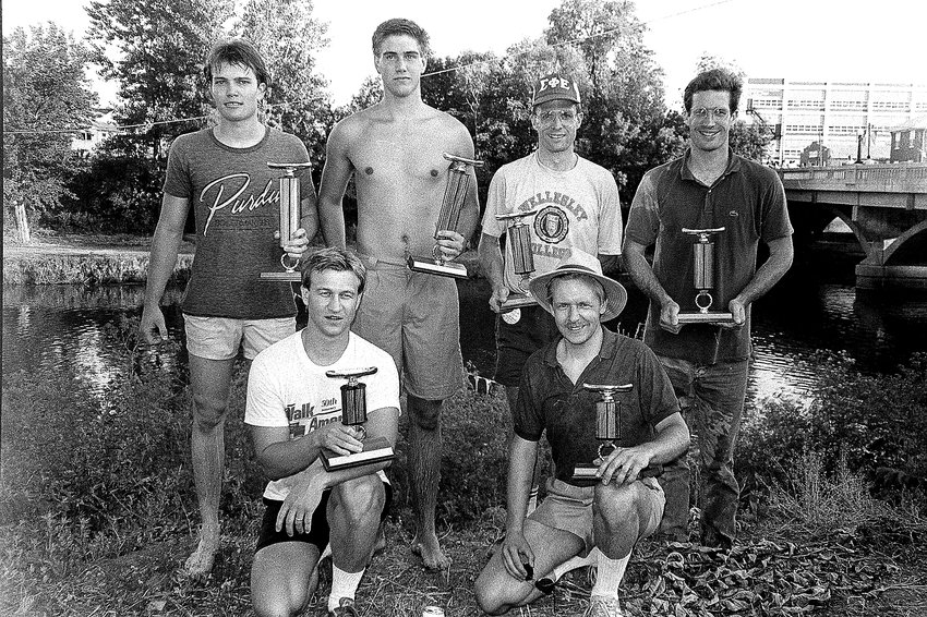 """This Galena Gazette throwback appeared in the July 13, 1988 edition. """"First place winners in the Hanover Days canoe race were Lucas Hudson of Cedarville and Mike Mellskog of Galena. They have won the race for the past five years. Pictured are, back, from left: Hudson and Mellskog; and William Hoff and David Hoff of Elizabeth, second; front: Ernie Streicher of Hanover and Greg Peterson of Toledo, Ohio, third place. The canoe race trophies were donated by Hal Patinkin of rural Hanover."""" For another Gazette throwback or to purchase a reprint, visit GalenaGazette.com. Gazette file photo"""