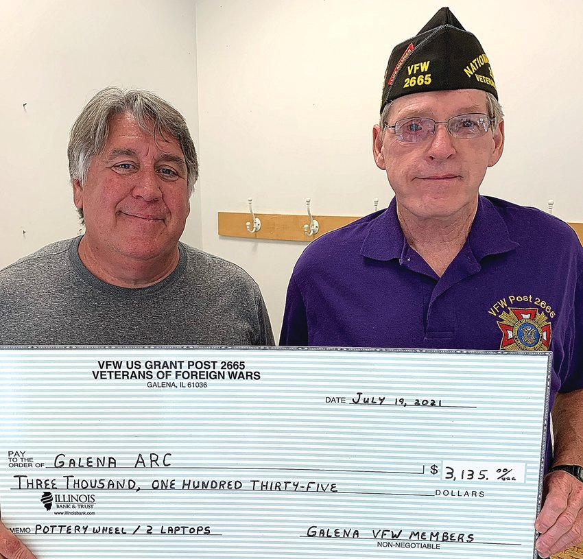 Galena VFW Post 2665 recently donated $3,135 to the Galena ARC for a pottery wheel for the art program and for two laptops for the new Scales Mound daycare. Commander George Petitgout, right, presented the check to Dave Decker, Galena ARC executive director. Hillary Dickerson photo
