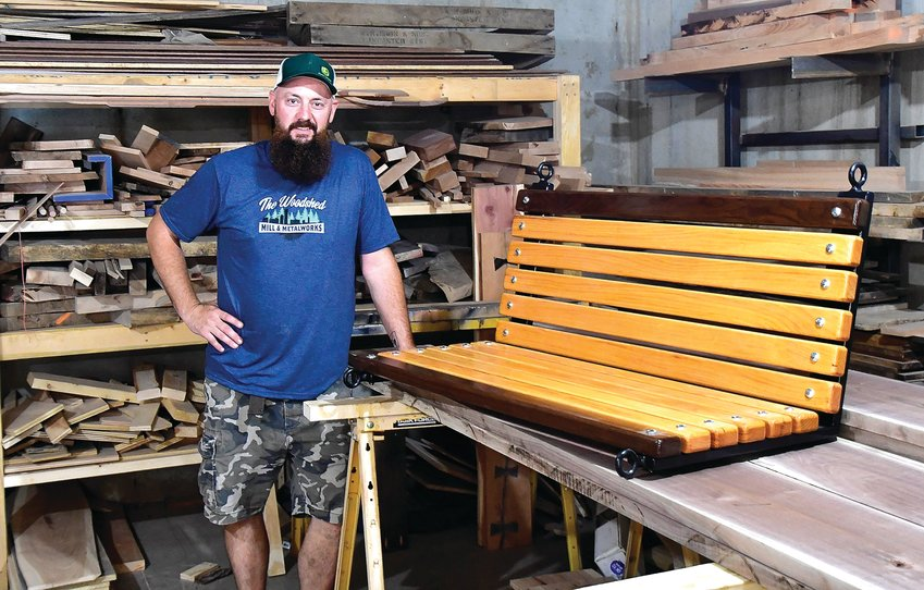 Ryan McClain, Galena, recently crafted a memorial swing bench, made out of walnut and honey locust, for a client. This is one of many creations he has recently completed at his shop. Brandon Behlke photo