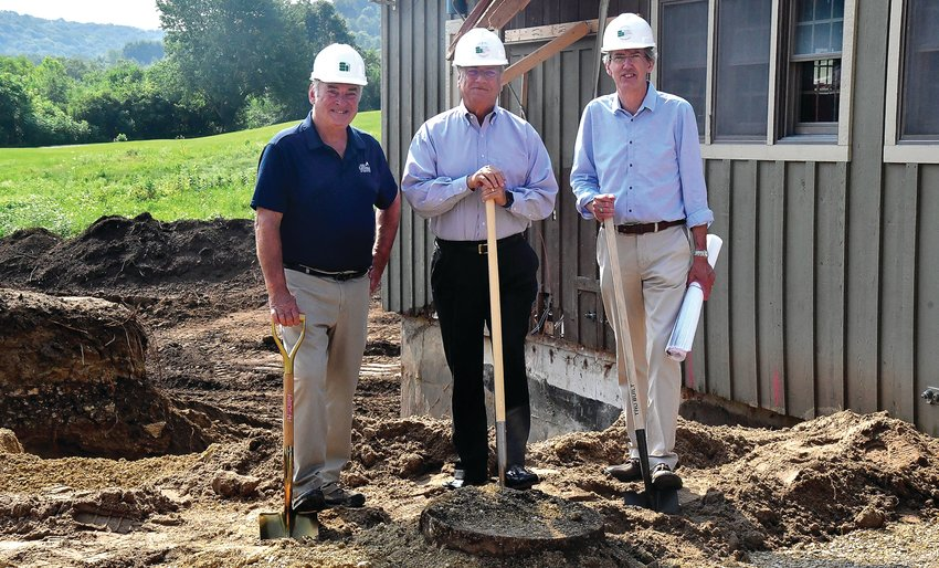 A groundbreaking ceremony was held on Tuesday, Aug. 10 at the future site of Stonedrift Spa. The spa will be located at the former site of the General Store at the corner of Wachter Road and Eagle Ridge Drive in The Galena Territory. From left: Mark Klausner, owner of Eagle Ridge Resort & Spa; Thomas Ruhs, general manager; and Marty Johnson, lead architect.