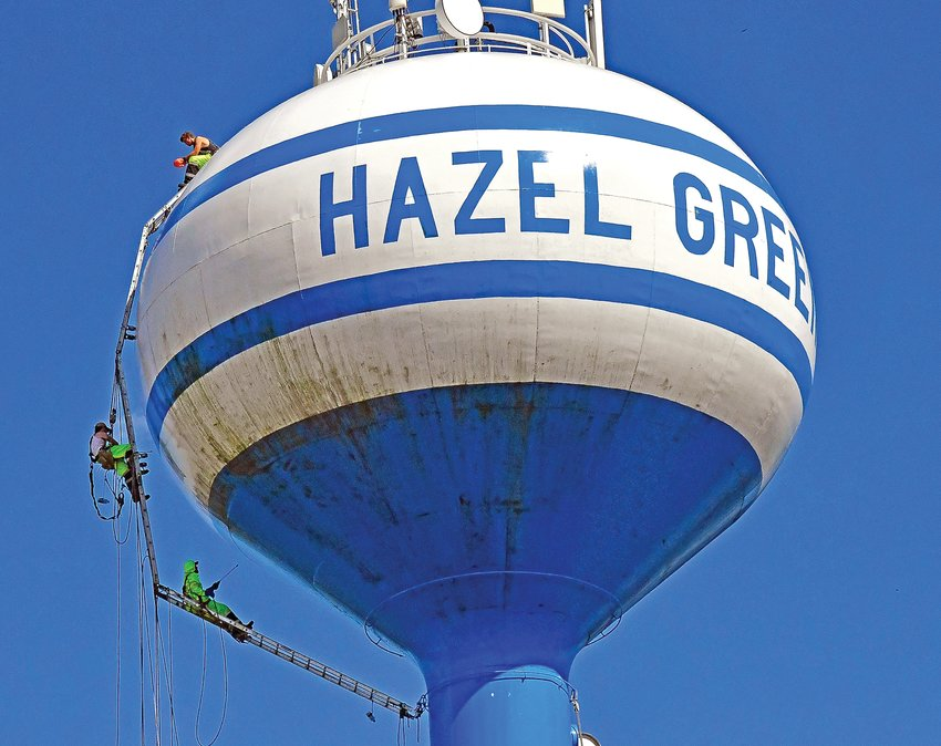 Crews from James Orr Coating Inspections, Madison, Wis., work on the Hazel Green water tower Aug. 13. Work will be ongoing on the structure for the next couple weeks. Village officials request residents not use water excessively. Brandon Behlke photo